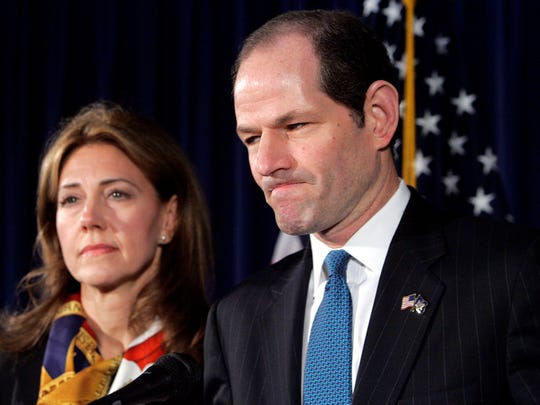 Democrat Eliot Spitzer announces his resignation as New York governor in 2008 with his wife, Silda, by his side.
