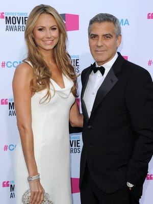 In happier times: George Clooney and Stacy Keibler at the Critics' Choice Movie Awards on Jan. 12, 2012.