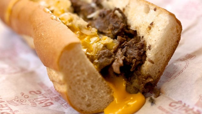 The Philly cheese steak is Philadelphia's signature dish -- a combination of chopped steak, cheese and onions served on a small loaf of bread, such as a hoagie roll.