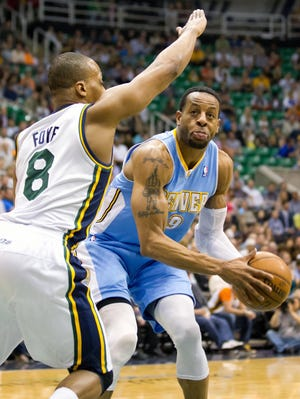 Andre Iguodala, right, and Randy Foye are part of a three-team trade, with Foye replacing Iguodala in Denver as he heads to Golden State.