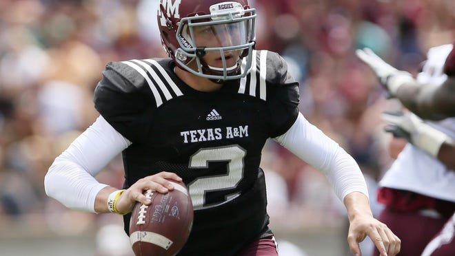Texas A,M quarterback Johnny Manziel, shown here during the Aggies' spring game April 13, heads the Maxwell Award watch list as ranked by USA TODAY Sports.