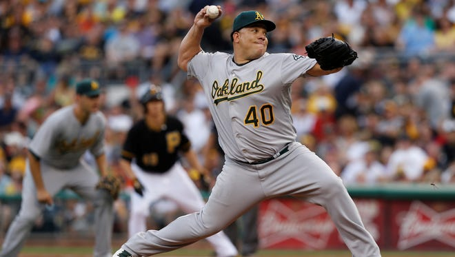 Oakland Athletics starting pitcher Bartolo Colon throws against the Pittsburgh Pirates in the third inning Monday.