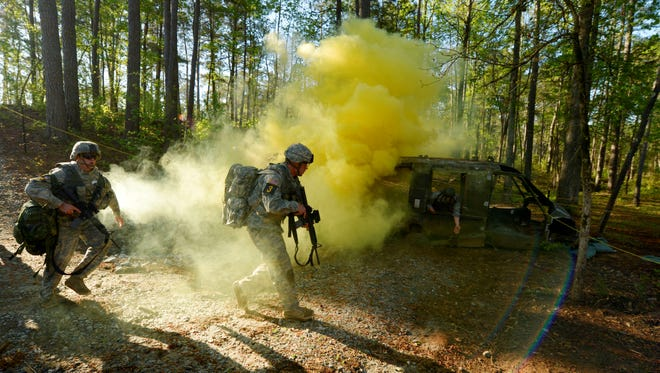 Army Rangers with the 1st Infantry Division arrive on site for a simulated injured soldier during the Ranger first responder course  at Fort Benning, GA in April, 2013. .