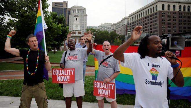 Jeffrey Jordan, right, of Philadelphia, leads a chant during a rally for gay marriage, June 26, 2013, on Independence Mall in Philadelphia.