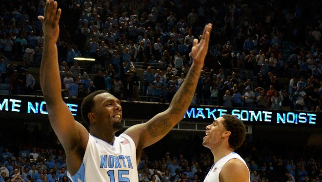 North Carolina guard P.J. Hairston (15) and forward James Michael McAdoo (43) exhort the crowd during the second half of a win against UNLV in December 2012.