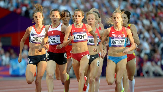 In a file photo from Aug 8, 2012,  Asli Cakir Alpetkin of Turkey (second from left) runs in the women's 1,500 at the London Olympics.