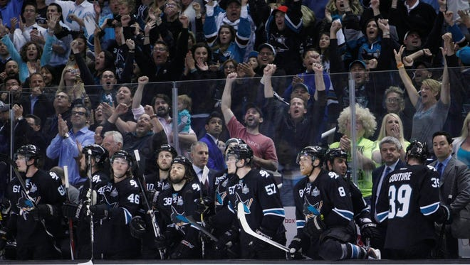 San Jose Sharks fans celebrate in the final seconds of the third period of game four of the Stanley Cup Playoffs against the Los Angeles Kings at HP Pavilion.