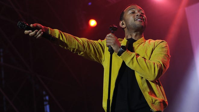 John Legend offers his mic to the audience  on July 9 in Milan, Italy.