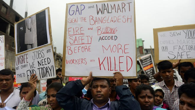 Reatives of Bangladeshi workers who lost their lives in a garment factory disaster protest in Savar, on the outskirts of Dhaka on June 29, 2013, at the site of Bangladesh's worst industrial disaster.