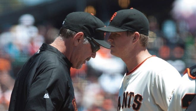 Giants manager Bruce Bochy takes the ball from starting pitcher Matt Cain on Wednesday. They have lost eight of nine.