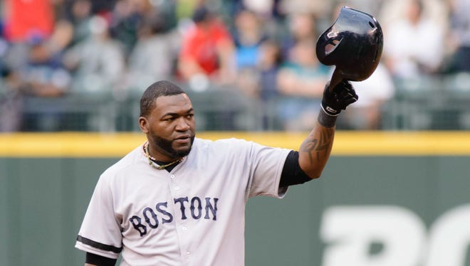 David Ortiz doubled for his 1,689th hit as a DH to set a new all-time record.