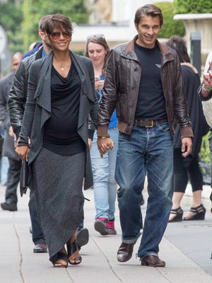 Halle Berry and Olivier Martinez are seen strolling on the Avenue Montaigne on June 11 in Paris.