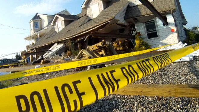 A house that was being raised above the flood zone after superstorm Sandy in Little Egg Harbor Township, N.J., collapsed Wednesday, July 11, 2013.  Three workers were injured and transported to hospitals.