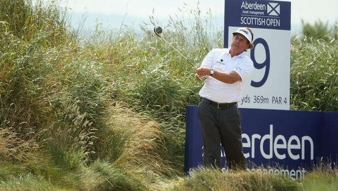 Phil Mickelson tees off on the 9th hole during the first round of the Aberdeen Asset Management Scottish Open.