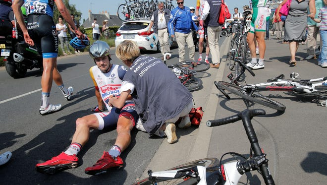 A doctor tends to Gregory Henderson of New Zealand after he crashed during the 12th stage of the Tour de France in Tours on Thursday.