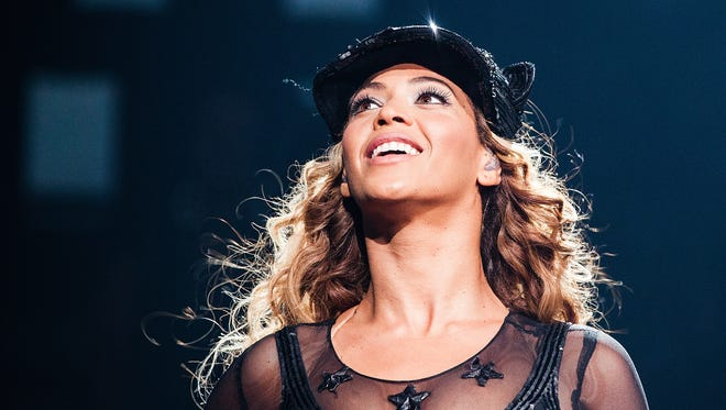 The real Beyonce performs on her Mrs. Carter Show world tour 2013, July 9 at the BB&T Center in  Fort Lauderdale.