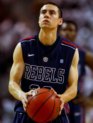 Mississippi Rebels guard Marshall Henderson (22) shoots a free throw during the game against the Mississippi State Bulldogs last season.