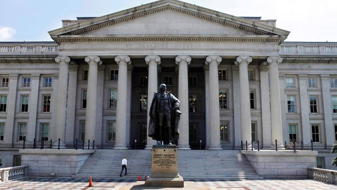 A statue of former Treasury Secretary Albert Gallatin stands outside the Treasury Building in Washington D.C.