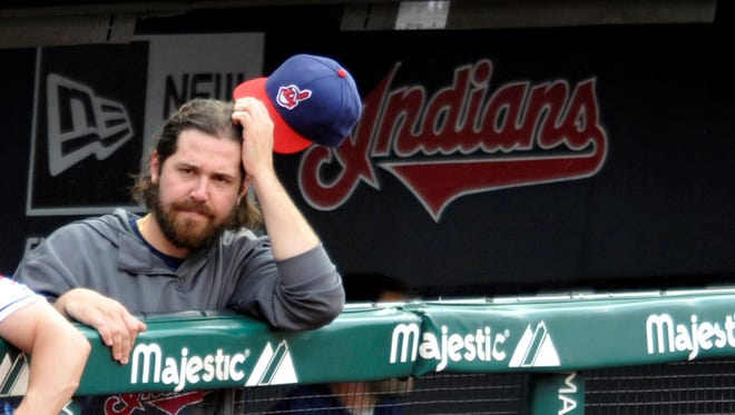 Jun 21, 2013; Cleveland, OH, USA; Cleveland Indians relief pitcher Chris Perez (54) watches the game in the second inning against the Minnesota Twins at Progressive Field.