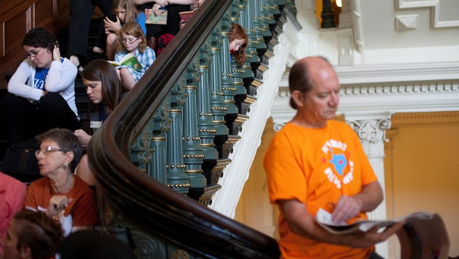 Hundreds wait in line to enter the Senate gallery at the Texas State Capitol in Austin, Texas on July 12.