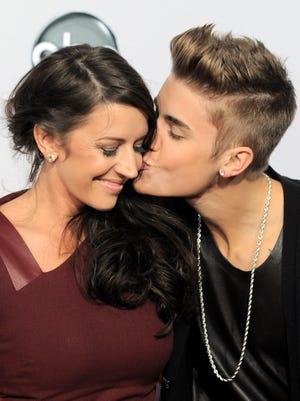 Justin Bieber puckers up to his mom, Pattie Mallette, last November.