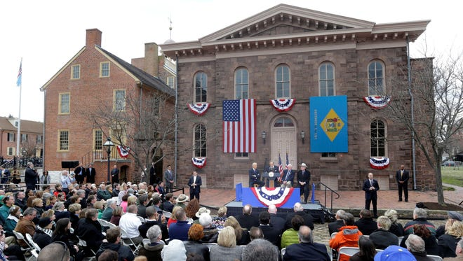 Dignitaries including Vice President Biden, on podium at left, gather March 26 in New Castle, Del., to celebrate the new historic status