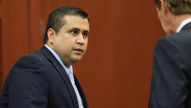 George Zimmerman speaks to his attorney Mark O'Mara after the jury left to deliberate during his trial in Seminole Circuit Court in Sanford, Fla., on Friday.
