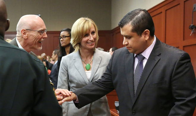 George Zimmerman, right, is congratulated by his defense team after being found not guilty.