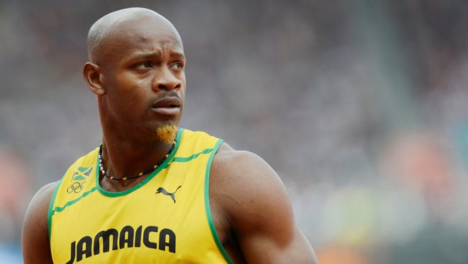 Asafa Powell reacts after competing in the men's 100 heats during the 2012 London Olympics on Aug. 4.