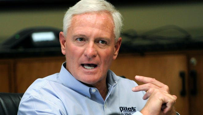 Jimmy Haslam announces he will stay on as the Pilot Flying J CEO on Friday in Knoxville, Tenn.