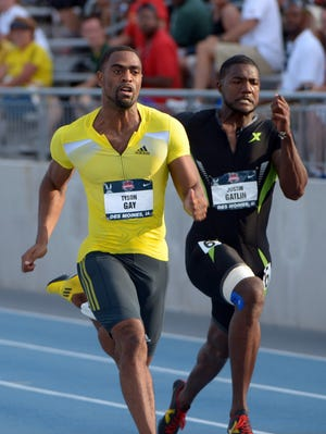 Tyson Gay (left) and Justin Gatlin compete in a 100 semifinal at the 2013 U.S. championships at Drake Stadium in Des Moines on June 21.