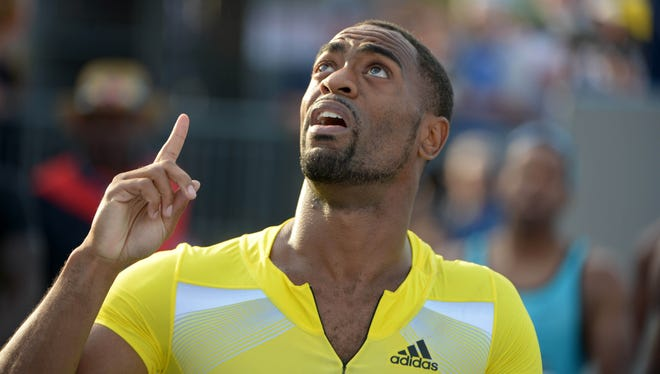 Tyson Gay reacts after winning a 100m semifinal in a wind-aided 9.75 in the 2013 USA Championships at Drake Stadium.