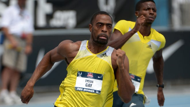 Tyson Gay, left,  wins the 200-meter semifinal in 20.07 in the 2013 USA Championships at Drake Stadium in June.