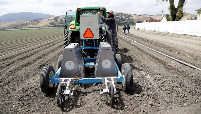 Field operations manager Matthew Rossow  tests the lettuce bot in Salinas, Calif.