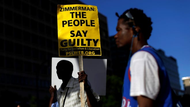 Protesters in Baltimore on Sunday reflected public opposition George Zimmerman will  continue to face nationwide following his acquittal in the shooting death of Trayvon Martin.