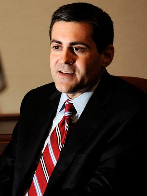 Russell Moore, the new president of the Southern Baptist's Ethics and Religious Liberty Commission, sits in the recording studio at the Southern Baptist Convention's office in Nashville.