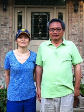Yu Dongyue (right), 46, shown in this photo with his sister, was reported missing Sunday, July 14, 2013, from an Indianapolis foot spa