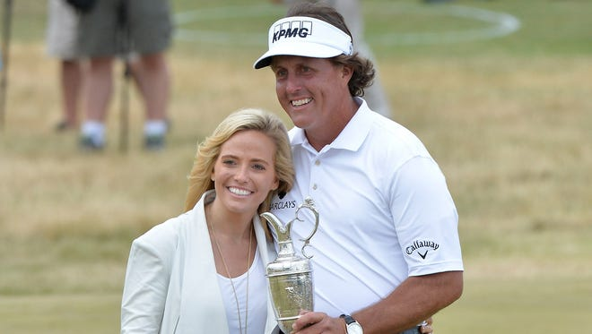 Phil Mickelson embraces the Claret Jug and his family after winning the British Open.