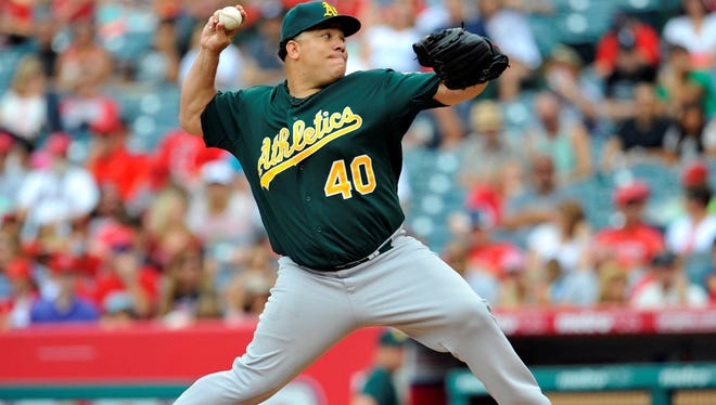 Oakland Athletics starting pitcher Bartolo Colon pitches during the first inning against the Los Angeles Angels.