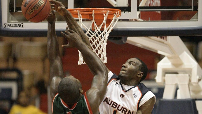 Auburn's Korvotney Barber (1) blocks the shot of Texas-Pan American's Nathan Hawkins (2) as teammate Rasheem Barrett (21) looks on during a game Jan. 27, 2009. Barber, who averaged a doulbe-double that season, was found drowned Sunday in Florida.
