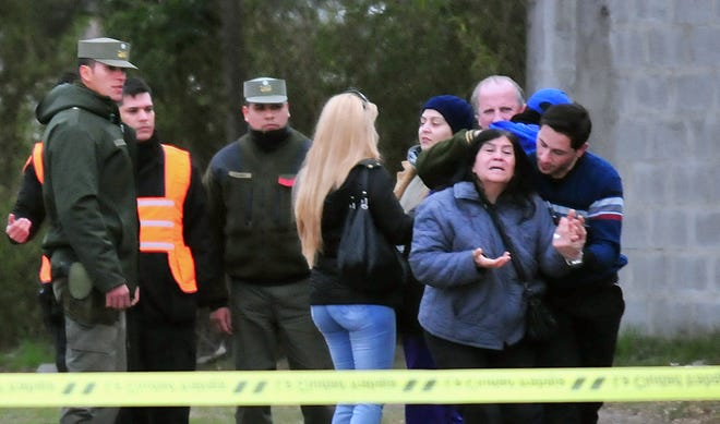 Relatives of one of the two men killed during a confrontation between factions of hooligans of Argentine football team Boca Juniors, react as they are notified about the death outside San Lorenzo stadium in Buenos Aires on Sunday.