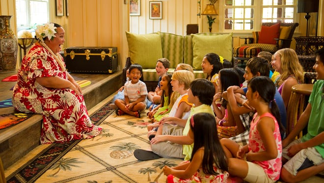 A storyteller entertains kids at Aunty's Beach House at Oahu's Aulani Resort. The resort's website says it focuses on Hawaiian culture.