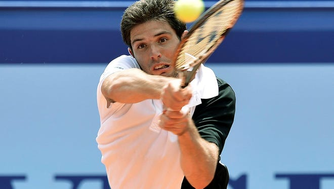 Federico Delbonis of Argentina returns a ball to Thomaz Bellucci of Brazil during a first round match at the Suisse Open tennis tournament in Gstaad, Switzerland.