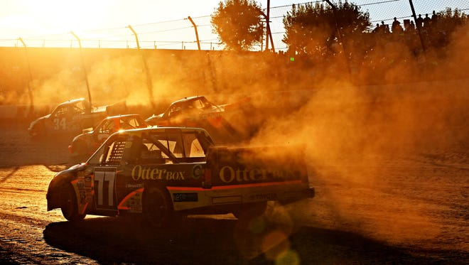 NASCAR Camping World Truck Series driver German Quiroga, Jr. races during qualifying for the Mudsummer Classic at Eldora Speedway in Rossburg, Ohio.