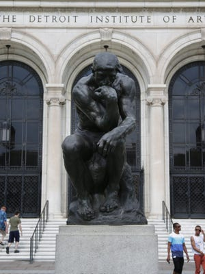 The Thinker by Auguste Rodin is shown in front of the Detroit Institute of Arts in Detroit  on Thursday, May 30, 2013.