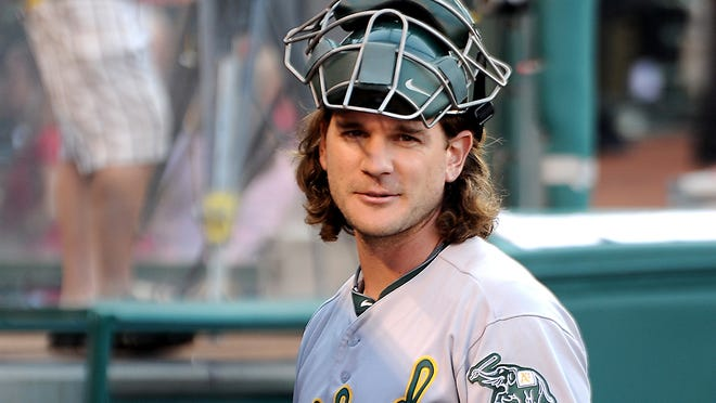 Oakland Athletics catcher John Jaso in the dugout before the start of a game against the Los Angeles Angels at Angel Stadium.