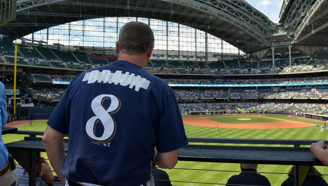 Bryan Von Declan shows his disappointment for the Milwaukee Brewers' Ryan Braun by taping over the name on the back of his jersey at Miller Park in Milwaukee.