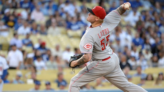 Cincinnati Reds starting pitcher Mat Latos pitches in the first inning against the Los Angeles Dodgers at Dodger Stadium.