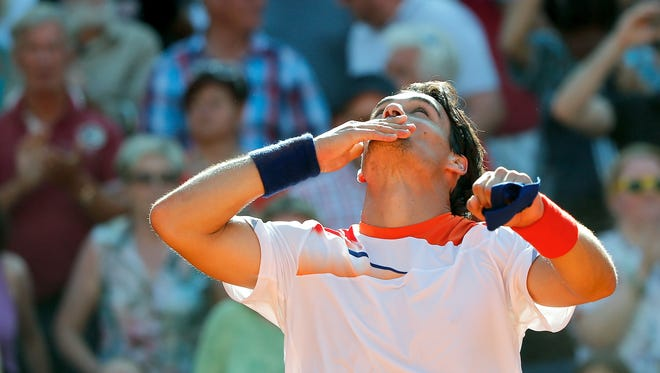 Italy's Fabio Fognini, shown here celebrating after he won the final match of the bet-at-home ATP tennis tournament, is headed to the semifinals of the Croatia Open.