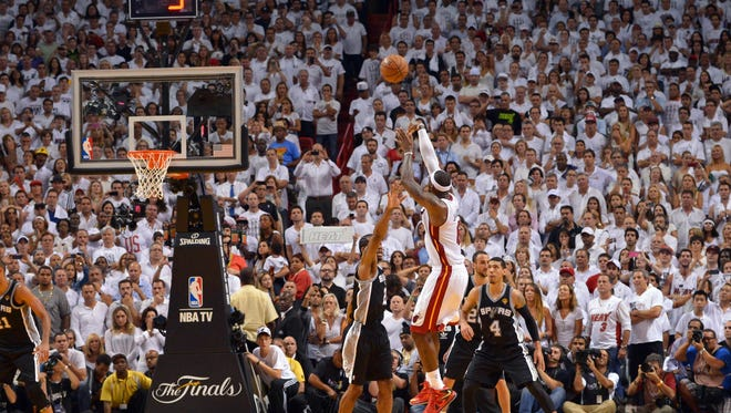Miami Heat small forward LeBron James  makes a jump shot in the last seconds of game seven in the 2013 NBA Finals at American Airlines Arena. Miami Heat won 95-88 to win the NBA Championship.